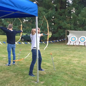 Corporate team learning archery