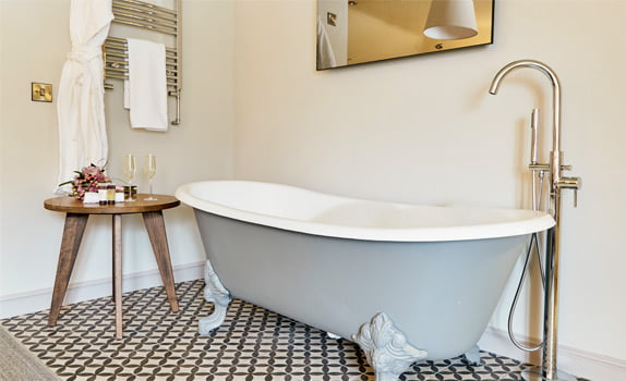 Freestanding bath in hotel room